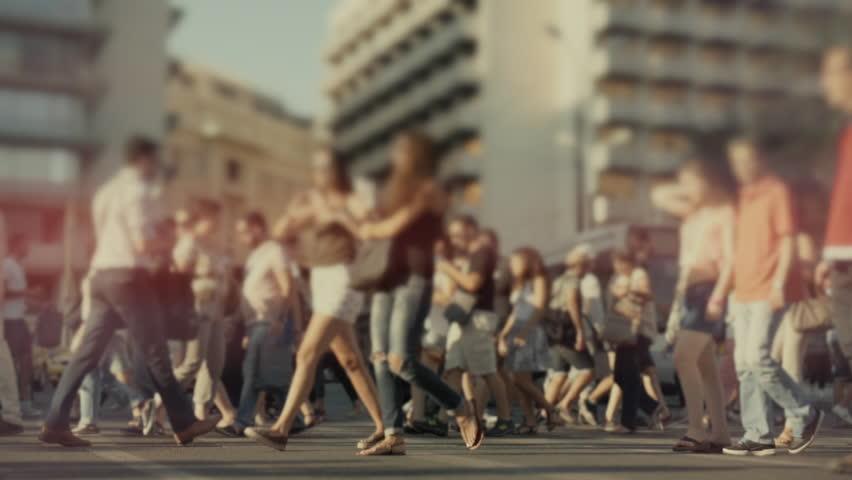 City crowd of pedestrians on summer day cross...