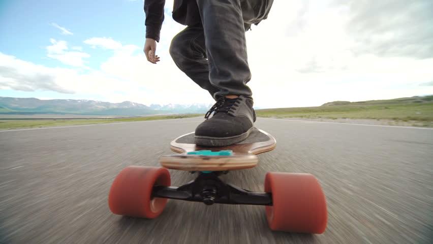 Close-up skateboarder boy riding outdoor