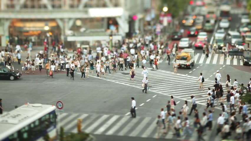 Thousands of people walk across the famous Shibuya Crossing in Tokyo Japan | Shutterstock Video #18564275