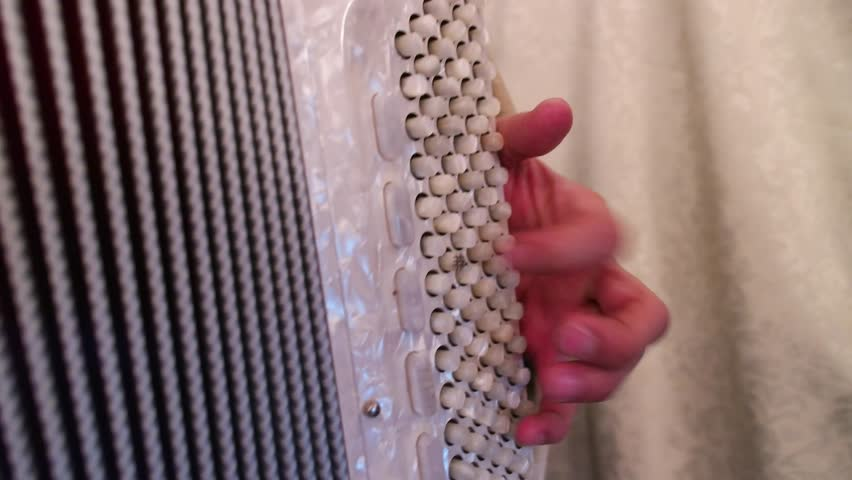 a man plays accordeon