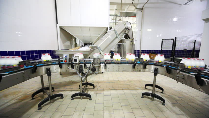 Packets to eight bottles of milk move roller conveyor on dairy factory, wide view   Shutterstock HD Video #1866418