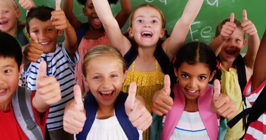 Portrait of school kids showing thumbs up in classroom at school 4k   Shutterstock HD Video #18695477