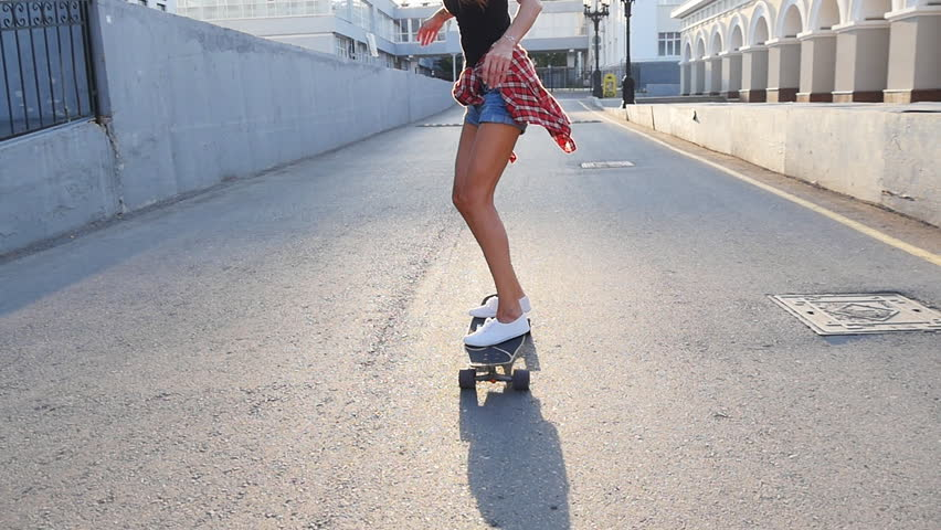 Woman skateboarding at sunrise. Legs on the skateboard, moves to success | Shutterstock Video #18757256