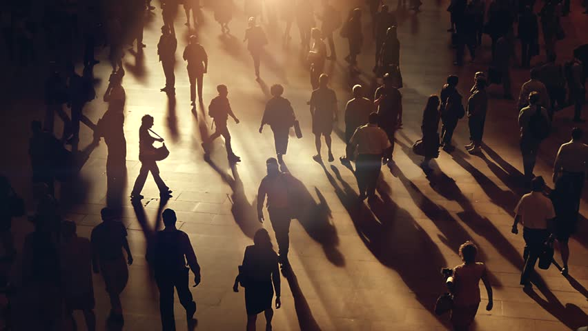 silhouette of unrecognizable people commuting in the city. crowded metropolis street scenery background    | Shutterstock Video #18809354