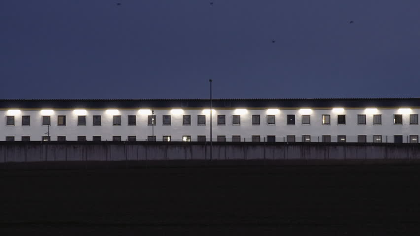 Tele shot of the facade of a prison in the early morning. Serene shot. | Shutterstock HD Video #18818831