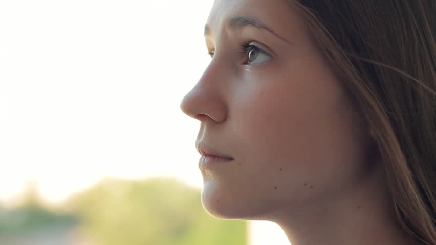 Profile Of A Teenage Girls Face, She Looks Hopeful Stock -4061