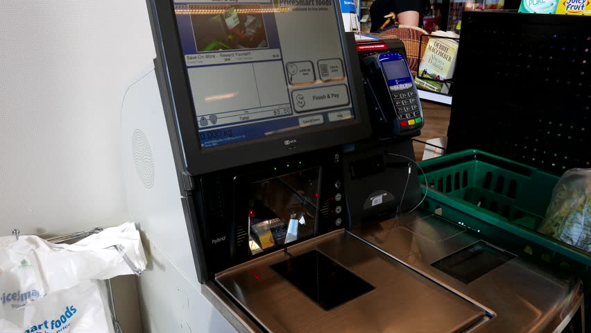 Burnaby, BC, Canada - August 10, 2016 : Close up of woman paying foods at self-check out counter inside Save on foods store | Shutterstock HD Video #18900008