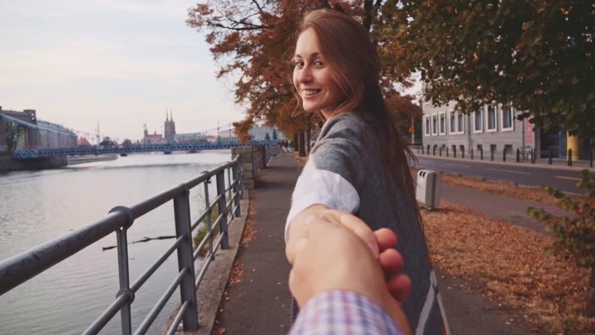 POINT OF VIEW: Young Woman Pulling her Boyfriend Through Autumn City Street. SLOW MOTION 120 fps. POV: Happy Girlfriend Makes her Man to Follow Her to the City Bridge.  | Shutterstock Video #18955547