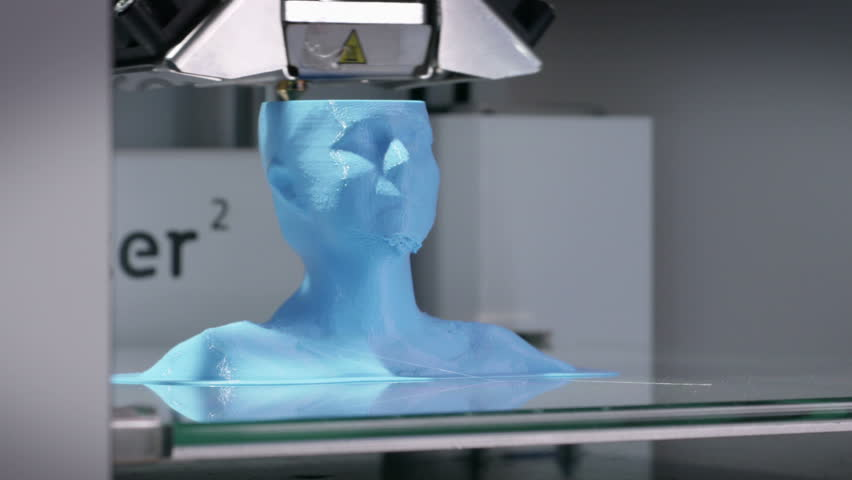 3D printing device working with plastic filament, printing a human bust. Time-lapse of a working  3D printer.