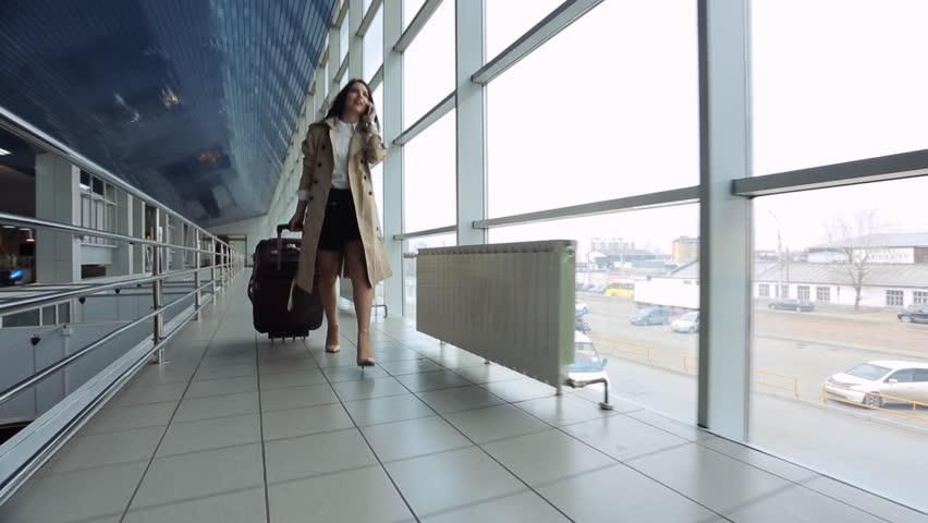 Young and beautiful woman is walking airport hall.   Shutterstock HD Video #19006942