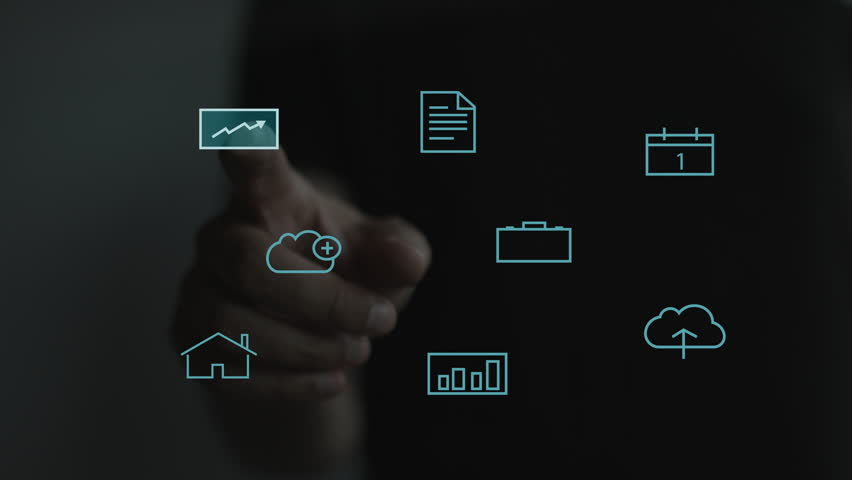 Businessman working on a holographic interface. Financial. Man touching a visual screen with holographic computer icons. Financial diagram with transparent statistics appearing on the touchscreen. 4K | Shutterstock HD Video #19068772