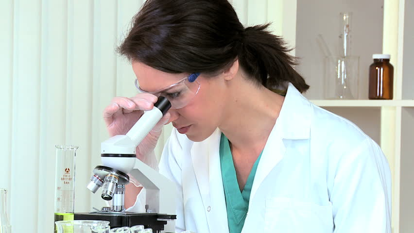 Research Assistant In Hospital Lab Using Microscope Stock Footage ...
