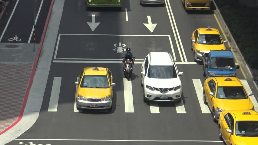 Taipei, Taiwan-21 June, 2016: 4K Aerial Traffic Cars, Motorbikes and Different Vehicles Driving On The Road in Busy Taipei City in the day-Dan   Shutterstock HD Video #19096795