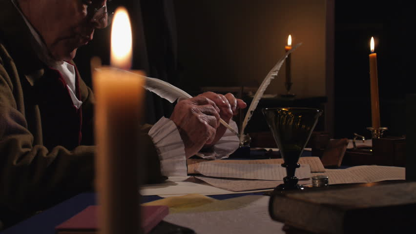 VIRGINIA - OCTOBER 2015 - Reenactment, Founding Fathers, American Revolutionary War era recreation -- Documents, Tabletop, quill writing, dipping ink and writing by candle light & by window, papers.