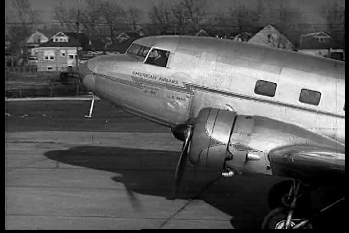 An airplane takes off. The pilots communicate with their base constantly in the 1950s. (1950s)