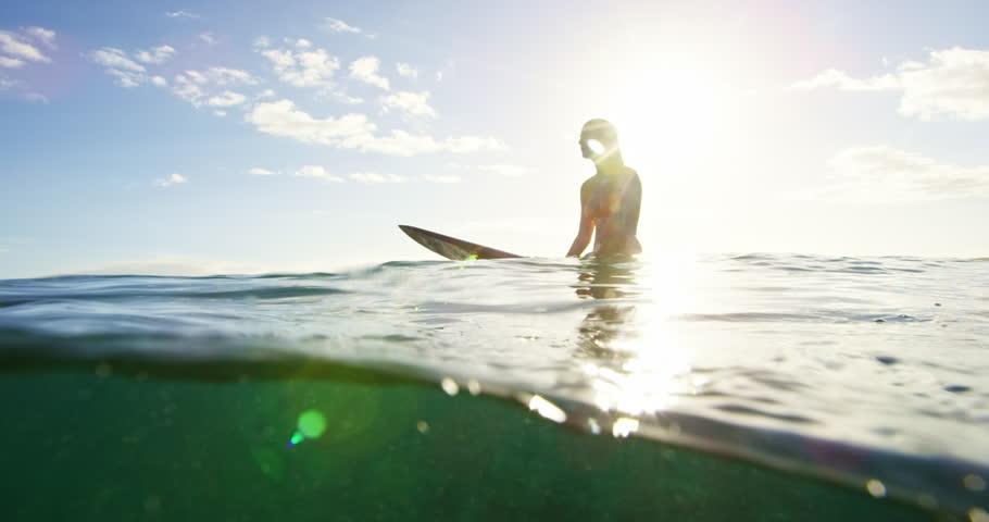 Beautiful surfer girl enjoying sunset surf | Shutterstock Video #19546066