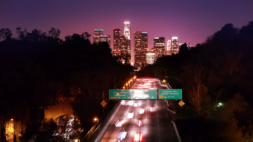 Downtown Los Angeles skyline and freeway city traffic at night. Timelapse. | Shutterstock HD Video #1962427