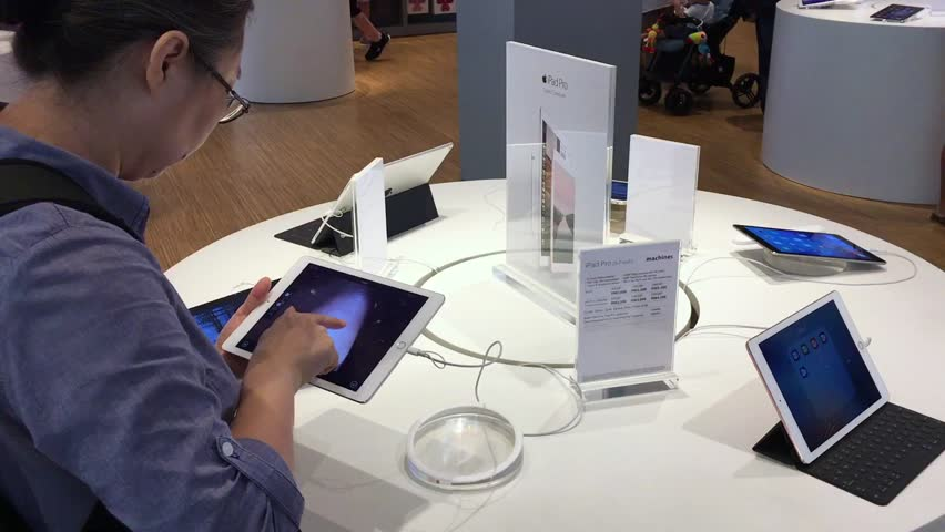 KUALA LUMPUR, MALAYSIA - 15 SEPTEMBER, 2016: new Apple iPad Pro sales in Malaysia. Women testing special designers soft.  | Shutterstock HD Video #19683334