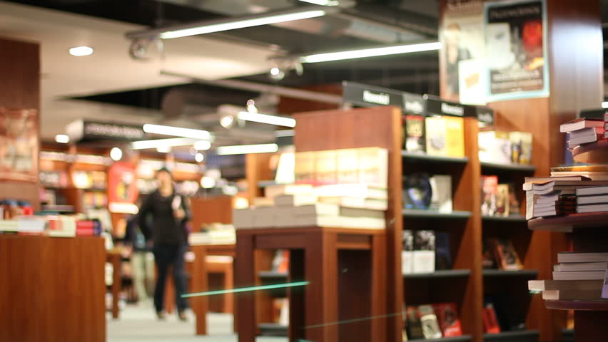 Bookstore shelves with book stacks