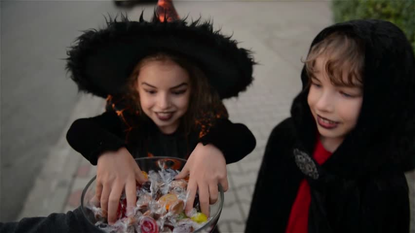Halloween, Kids Want Halloween Candy, Children wearing witch costumes with hats, Kids trick or treat.   Shutterstock Video #19801111