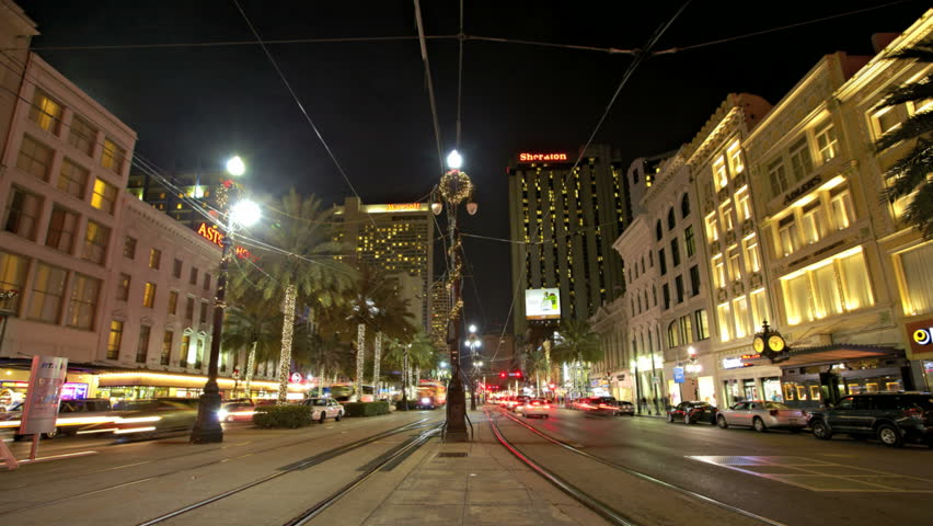 NEW ORLEANS  - DEC 09: Timelapse of a traffic in Canal Street at night on