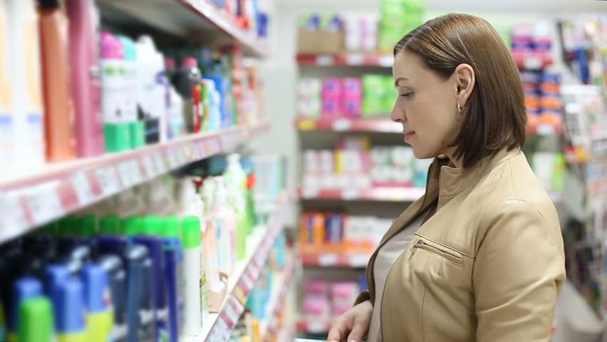 Woman buys shampoo   Shutterstock HD Video #19954549