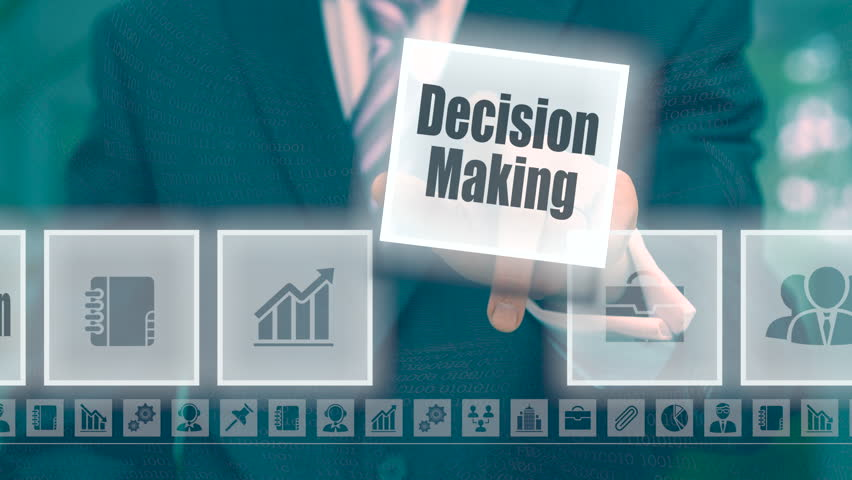 Businessman selecting and then pressing a Decision Making button on a clear projection screen   Shutterstock HD Video #19981468