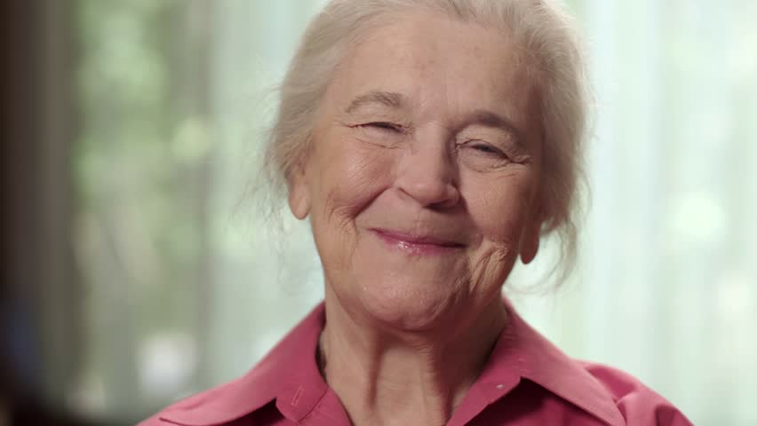 Close up of a happy elderly senior woman smiling. Shot in 4K UHD.