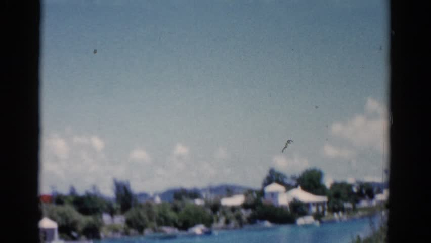 FLORIDA 1951: shaky spy video of tropical area mansion homes across water
