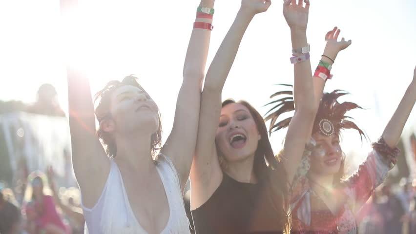 Female friends dancing at summer festival | Shutterstock HD Video #20116630