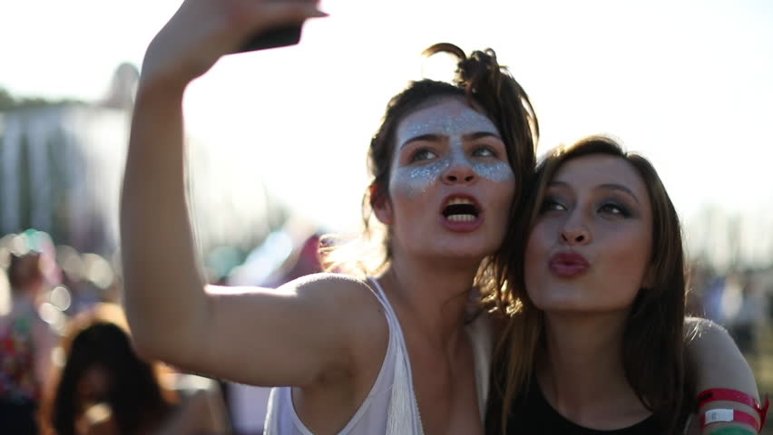 Female friends taking selfie at summer festival | Shutterstock HD Video #20116669