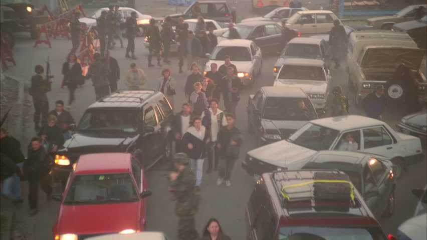day High down traffic jam, some accidents, people panic run thru cars, military soldiers national guards, evacuation, chaos, disaster
