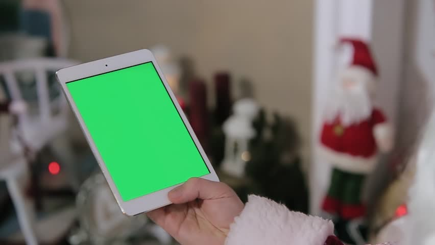Santa Claus Using Digital Tablet Green Screen. Tablet with Green Screen in Vertical Mode. Easy for tracking and keying.