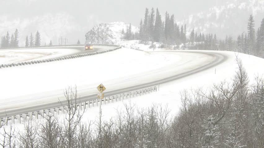 Semi trailer truck on snowy winter highway