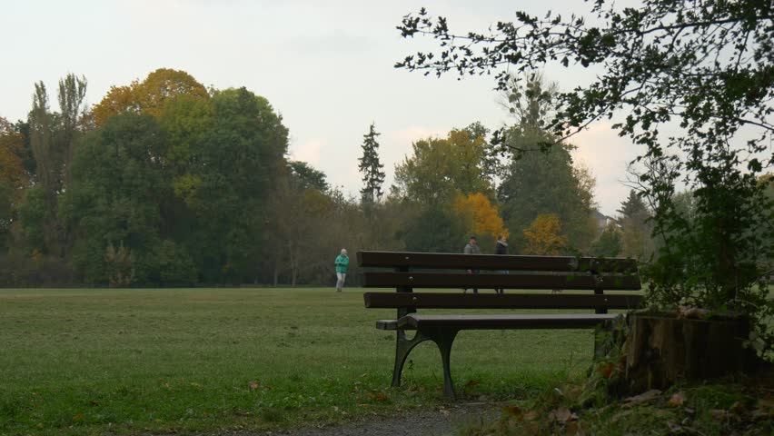 Video Bench Part - 33: Man With Bicycle Is Walking And Sits Down To The Bench In Park Holding  Mobile Phone