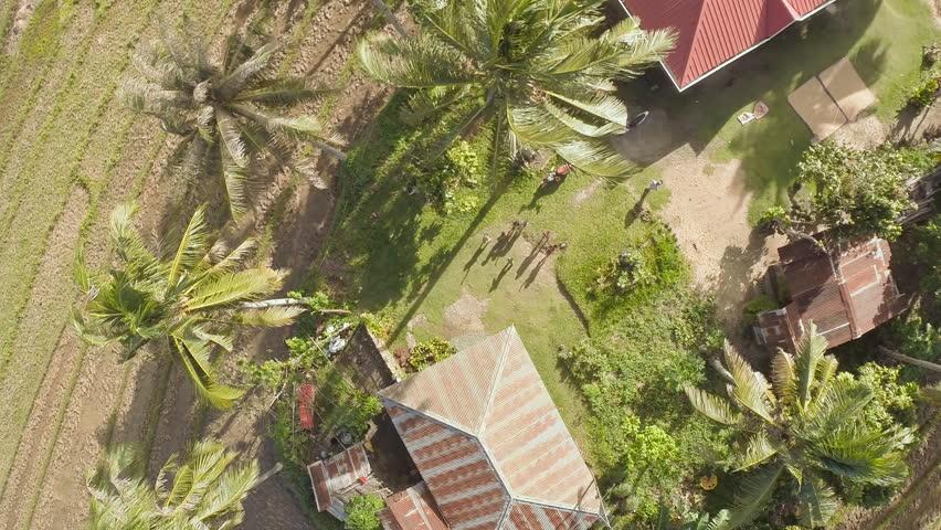 CANDIJAY, BOHOL, PHILIPPINES - NOVEMBER 20, 2015: Childrens in the Philippine village. Bohol island. Aerial views.