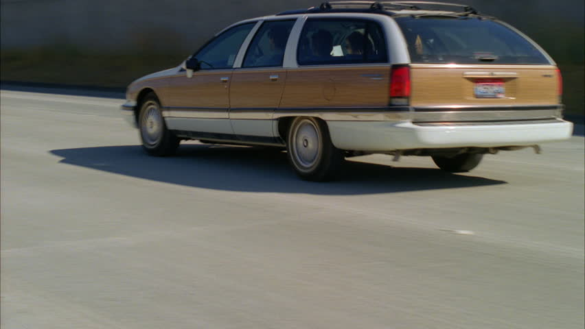 Day Low angle older white station wagon wood paneling, away ND freeway highway away traffic approx. 10 seconds , light | Shutterstock HD Video #20853868