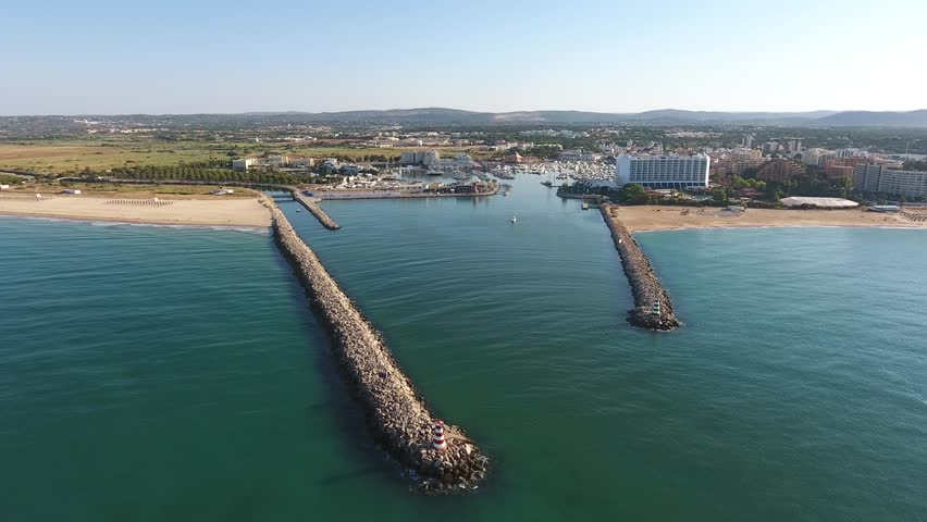 Flying over the entrance to the Marina dock. Vilamoura | Shutterstock HD Video #20921425