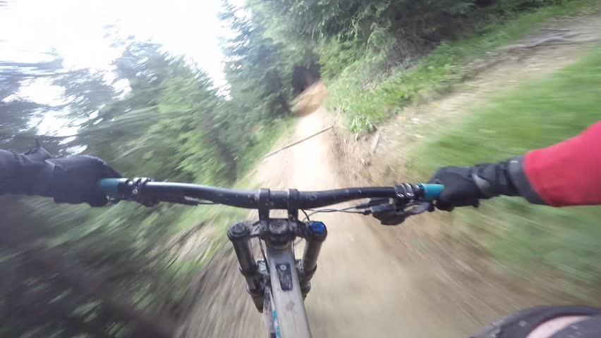 Mtb Mountain biker crash with downhill bike. Cyclist rides a single trail with berms, hits a tree with his handlebars and crashes.