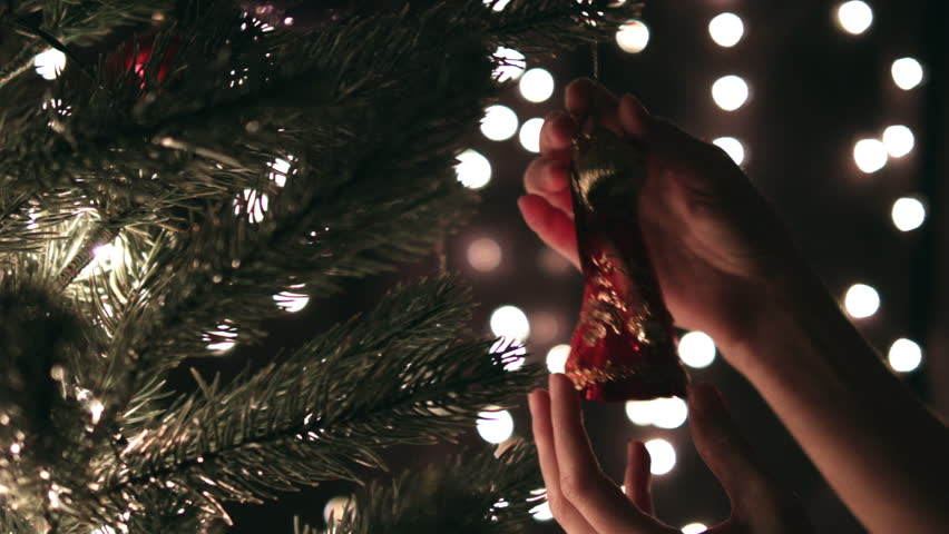 Hanging Christmas decoration on tree with Christmas lights.  Decorating on Christmas tree with ball. | Shutterstock HD Video #21027421