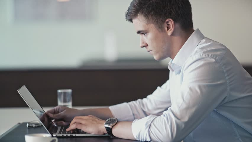 Young man in office | Shutterstock HD Video #21153523