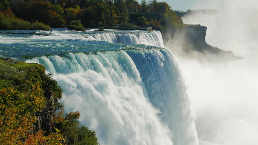 The famous waterfall Niagara Falls, a popular spot among tourists from all over the world. The view from the American side. In the picture, one can see at once two waterfalls ProRes HQ 422 10 bit