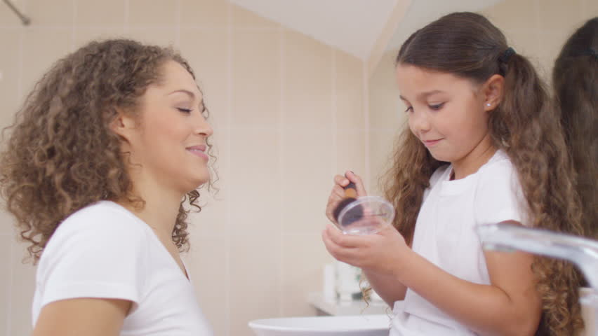 4K Little girl watching her mother get ready in the bathroom and playing  with her make. Brother And Sister In Bathroom