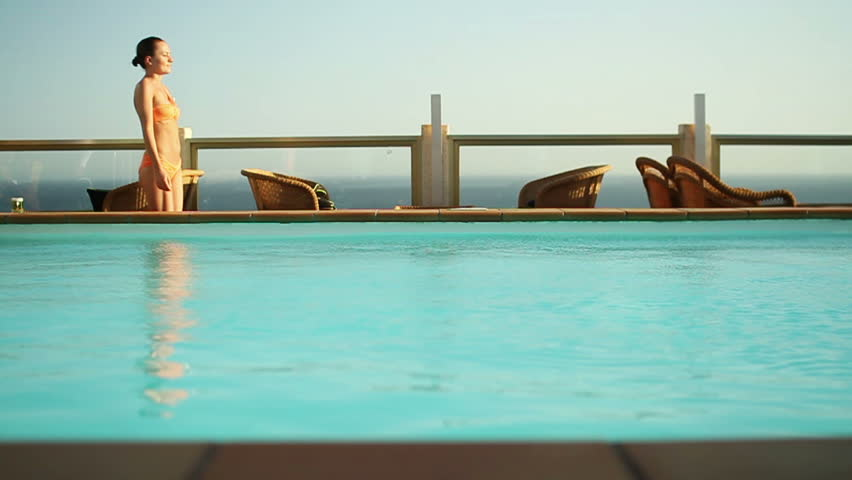 Happy young woman relaxing by the luxury swimming pool stock footage video 2165810 shutterstock for Female only swimming pool london