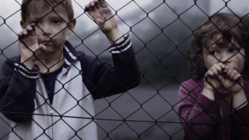 Children's loneliness. Abandoned. Homelessness. Orphans in slums. Video clip shows lonely children. Orphans in the refugee camp. Static Shot. Clip ID: children4_HD