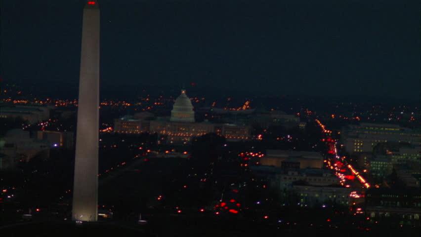 night Aerial Over Washington DC, holding Capitol Building, passes Washington Monument