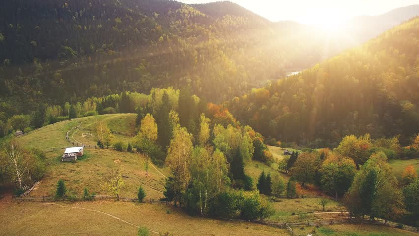 Aerial Drone Footage View: Flight over autumn mountain village with forests, fields and river in sunrise soft light. Carpathian Mountains, Ukraine, Europe. Majestic landscape. Beauty world. 4K   Shutterstock Video #21477811