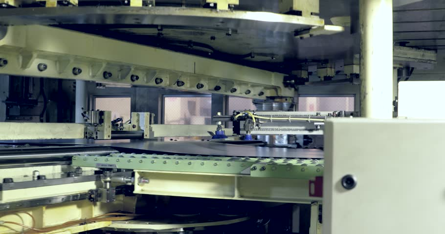 Robots are pressing metal sheet in production line in automobile factory | Shutterstock HD Video #21557884