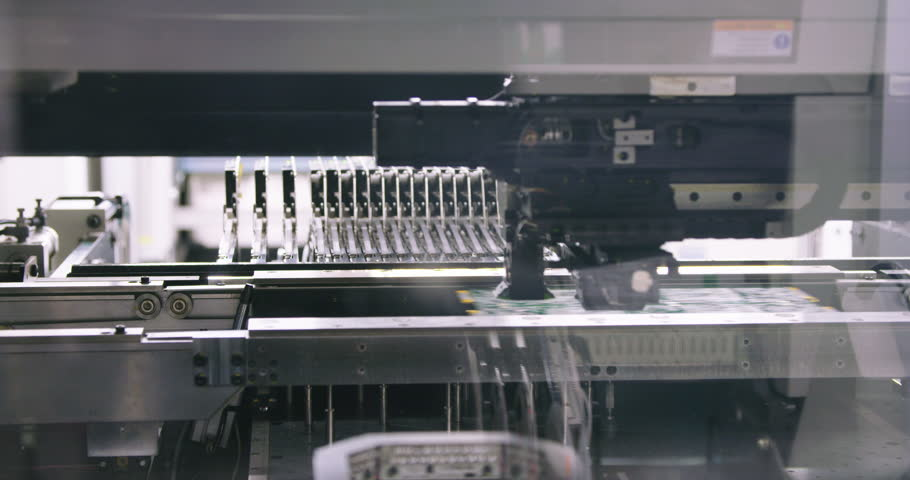 Surface Mount Technology (Smt) Machine places resistors, capacitors, transistors, LED and integrated circuits on circuit boards at high speed | Shutterstock HD Video #21678169