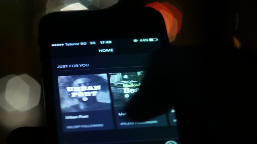 PLOVDIV, BULGARIA, NOVEMBER 2016: Fingers browsing Spotify music application on a touchscreen device #21731971